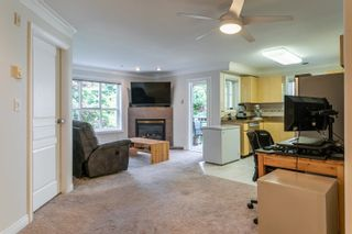 """Photo 2: 214 8115 121A Street in Surrey: Queen Mary Park Surrey Condo for sale in """"The Crossing"""" : MLS®# R2594503"""