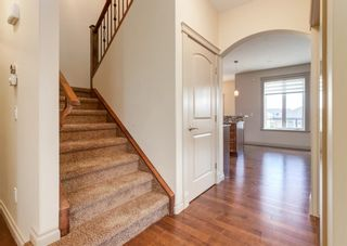 Photo 6: 66 ASPENSHIRE Place SW in Calgary: Aspen Woods Detached for sale : MLS®# A1106205