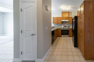 Photo 7: 404 720 Willowbrook Road NW: Airdrie Row/Townhouse for sale : MLS®# A1098346