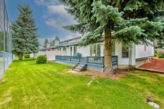 Photo 43: 34 Woodmeadow Close SW in Calgary: Woodlands Semi Detached for sale : MLS®# A1127227