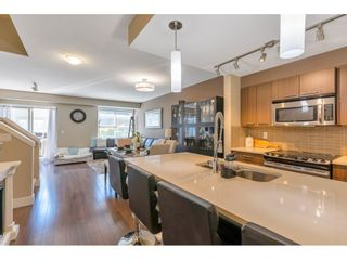"""Photo 6: 220 2110 ROWLAND Street in Port Coquitlam: Central Pt Coquitlam Townhouse for sale in """"AVIVA ON THE PARK"""" : MLS®# R2598714"""
