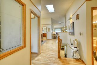 Photo 7: 20A Woodmeadow Close SW in Calgary: Woodlands Row/Townhouse for sale : MLS®# A1127050