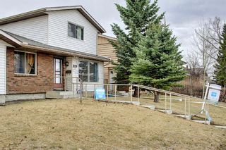 Photo 3: 329 Woodvale Crescent SW in Calgary: Woodlands Semi Detached for sale : MLS®# A1093334