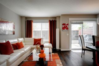 Photo 11: 15 West Coach Manor SW in Calgary: West Springs Row/Townhouse for sale : MLS®# A1100327