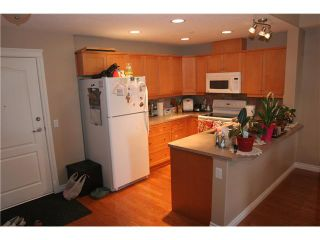 Photo 3: 107 2121 98 Avenue SW in CALGARY: Palliser Condo for sale (Calgary)  : MLS®# C3574647
