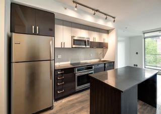 Photo 2: 409 550 Riverfront Avenue SE in Calgary: Downtown East Village Apartment for sale : MLS®# A1139717