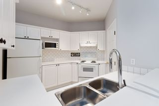"Photo 9: 311 8142 120A Street in Surrey: Queen Mary Park Surrey Condo for sale in ""STERLING COURT"" : MLS®# R2434284"