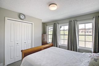 Photo 19: 314 Ascot Circle SW in Calgary: Aspen Woods Row/Townhouse for sale : MLS®# A1111264