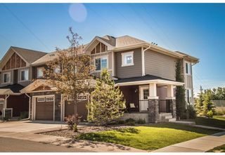 Photo 1: 95 West Coach Manor SW in Calgary: West Springs Row/Townhouse for sale : MLS®# A1114599