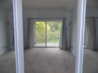 "Photo 9: 311 6420 194 Street in Surrey: Clayton Condo for sale in ""WATERSTONE"" (Cloverdale)  : MLS®# R2575596"
