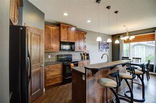Photo 8: 417 Cimarron Boulevard: Okotoks Detached for sale : MLS®# C4301022
