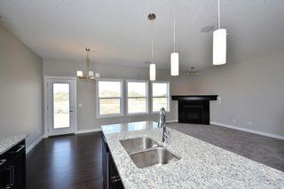 Photo 8: 52 Savanna Road NE in Calgary: Saddle Ridge House for sale : MLS®# C4119489