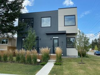 Main Photo: 905 39 Street SW in Calgary: Rosscarrock Row/Townhouse for sale : MLS®# A1140412
