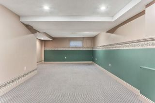 Photo 16: 51 SANDRINGHAM Way NW in Calgary: Sandstone Valley House for sale