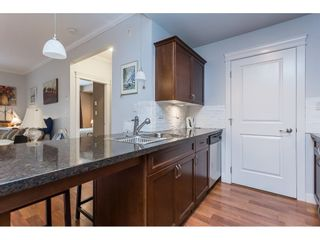 """Photo 12: 109 33338 MAYFAIR Avenue in Abbotsford: Central Abbotsford Condo for sale in """"The Sterling"""" : MLS®# R2558844"""
