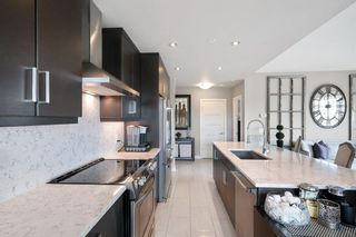 Photo 11: 212 145 Burma Star Road SW in Calgary: Currie Barracks Apartment for sale : MLS®# A1133906