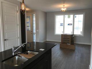 Photo 24: 23 Sunrise Heights: Cochrane Duplex for sale : MLS®# A1017998