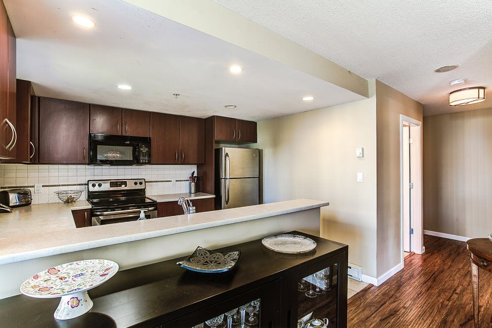 """Photo 9: Photos: 403 235 GUILDFORD Way in Port Moody: North Shore Pt Moody Condo for sale in """"THE SINCLAIR"""" : MLS®# R2187020"""