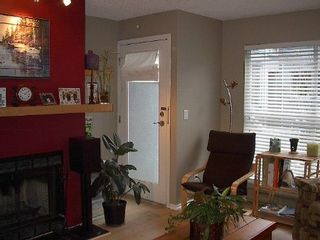 Photo 6: RENOVATED TOWNHOUSE!