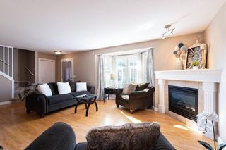 Photo 5: 16 SOMME Way SW in Calgary: Garrison Woods Semi Detached for sale : MLS®# C4232811