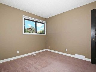Photo 14: 232 RANCHERO Place NW in CALGARY: Ranchlands Residential Detached Single Family for sale (Calgary)  : MLS®# C3583167