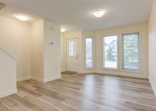 Photo 5: 402 2445 Kingsland Road SE: Airdrie Row/Townhouse for sale : MLS®# A1107683