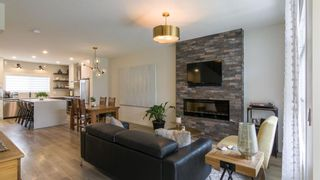Photo 3: 46 Wolf Creek Manor SE in Calgary: C-281 Detached for sale : MLS®# A1145612