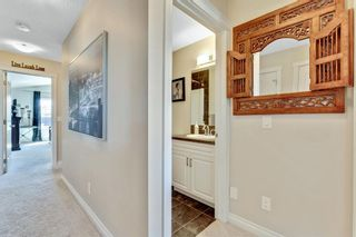Photo 27: 744 RIVER HEIGHTS Crescent: Cochrane Semi Detached for sale : MLS®# A1026785