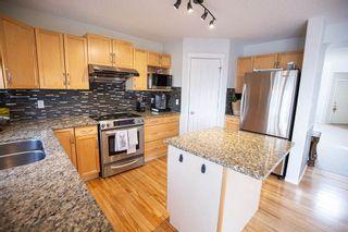 Photo 3: 6985 STROM Lane in Edmonton: Zone 14 House for sale : MLS®# E4237022