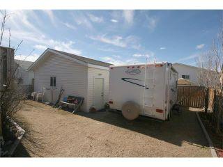 Photo 41: 35 WEST MCDOUGAL Road: Cochrane House for sale : MLS®# C4053037