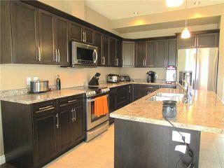 """Photo 6: 10409 109TH Street in Fort St. John: Fort St. John - City NE 1/2 Duplex for sale in """"SUNSET RIDGE"""" (Fort St. John (Zone 60))  : MLS®# N229918"""