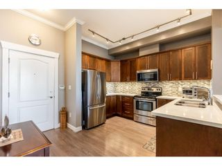 """Photo 2: 405 2627 SHAUGHNESSY Street in Port Coquitlam: Central Pt Coquitlam Condo for sale in """"Villagio"""" : MLS®# R2595502"""