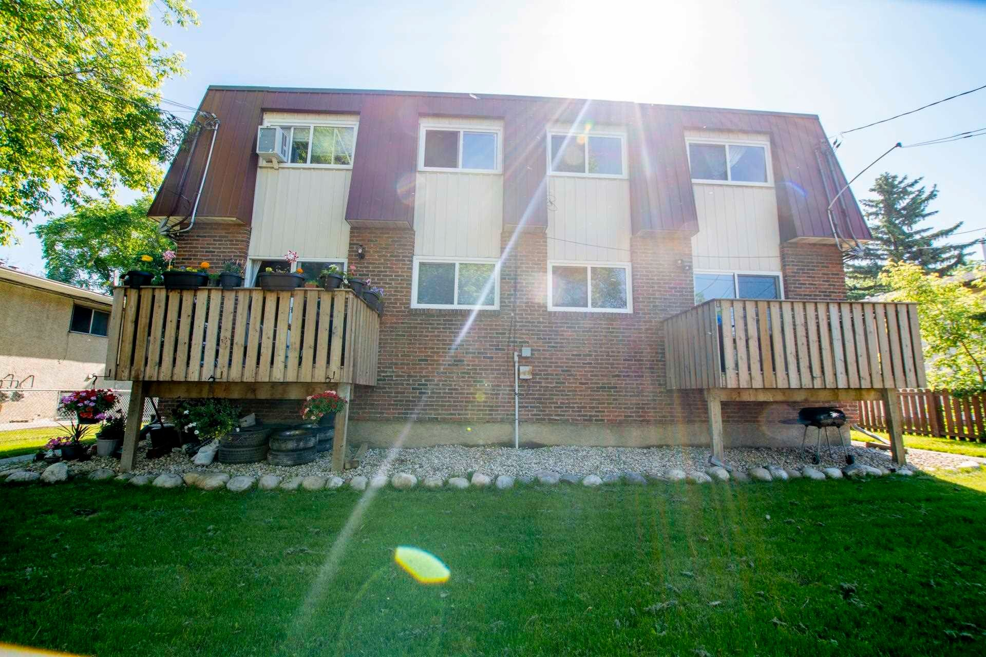 Main Photo: 12016 12018A 69 Street in Edmonton: Zone 06 House Duplex for sale : MLS®# E4256657