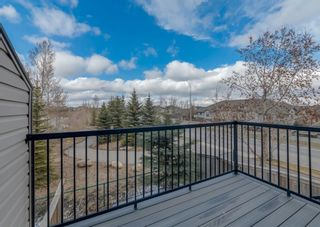 Photo 7: 4 Eversyde Park SW in Calgary: Evergreen Row/Townhouse for sale : MLS®# A1098809