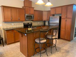 Photo 5: 1407 GLASTONBURY Boulevard in Edmonton: Zone 58 House Half Duplex for sale : MLS®# E4254936