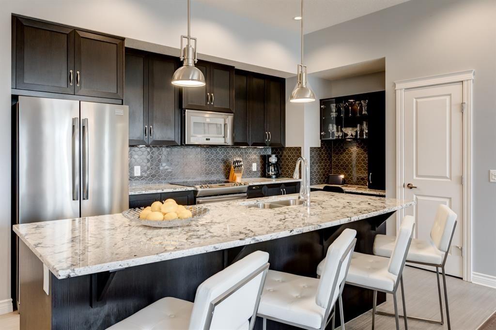 Photo 4: Photos: 312 39 Quarry Gate SE in Calgary: Douglasdale/Glen Apartment for sale : MLS®# A1103022