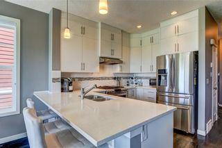 Photo 7: 2101 881 SAGE VALLEY Boulevard NW in Calgary: Sage Hill Row/Townhouse for sale : MLS®# C4305012