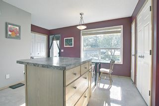 Photo 10: 403 950 Arbour Lake Road NW in Calgary: Arbour Lake Row/Townhouse for sale : MLS®# A1140525