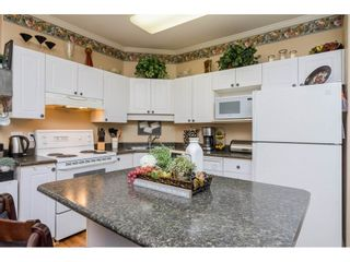 """Photo 7: 106 33502 GEORGE FERGUSON Way in Abbotsford: Central Abbotsford Condo for sale in """"Carina Court"""" : MLS®# R2262879"""