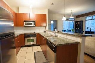Photo 2: 219 100 CAPILANO ROAD in Port Moody: Port Moody Centre Condo for sale : MLS®# R2050259