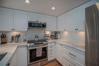 "Photo 4: 1307 295 GUILDFORD Way in Port Moody: North Shore Pt Moody Condo for sale in ""THE BENTLEY"" : MLS®# R2610666"