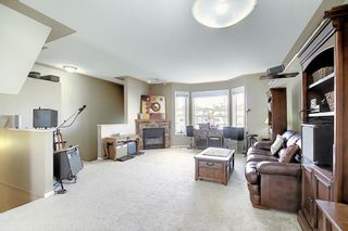 Photo 4: 121 Country Hills Gardens NW in Calgary: Country Hills Row/Townhouse for sale : MLS®# A1057496