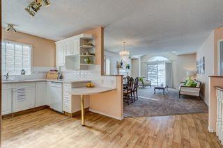 Photo 2: 11 HARVEST LAKE VI NE in Calgary: Harvest Hills House for sale : MLS®# C4171329