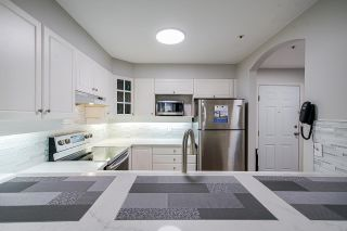 """Photo 9: 104 20125 55A Avenue in Langley: Langley City Condo for sale in """"Blackberry II"""" : MLS®# R2484759"""