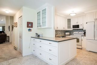 """Photo 14: 12 8737 212 Street in Langley: Walnut Grove Townhouse for sale in """"Chartwell Green"""" : MLS®# R2607047"""