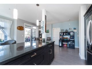 """Photo 6: 104 20062 FRASER Highway in Langley: Langley City Condo for sale in """"Varsity"""" : MLS®# R2453386"""