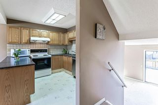 Photo 16: 1413 Ranchlands Road NW in Calgary: Ranchlands Row/Townhouse for sale : MLS®# A1133329