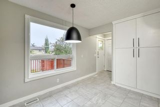 Photo 7: 215 Strathearn Crescent SW in Calgary: Strathcona Park Detached for sale : MLS®# A1146284