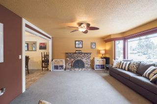 """Photo 2: 4469 202A Street in Langley: Langley City House for sale in """"BROOKSWOOD"""" : MLS®# R2134697"""