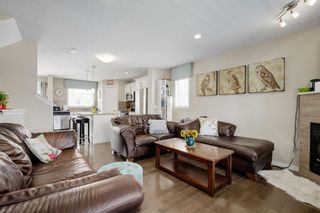 Photo 4: 203 CRANBERRY Park SE in Calgary: Cranston Row/Townhouse for sale : MLS®# A1063475